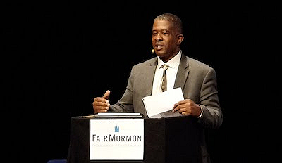 "Perkins was born in 1963 in Niagara Falls, New York, to Cecil and Cora Perkins. One of six children, he attended many different Christian churches growing up. When he was twenty-five in 1988, he joined The Church of Jesus Christ of Latter-day Saints. He studied at Western Governors University in Salt Lake City and received a BS in Business Management. He is currently married to the former Ani Crespo. They have three children and live in Los Angeles where he works as a human capital management software sales director.Perkins has served in many capacities in the LDS Church, including director of African American Relations on the Southern California Public Affairs Council, Gospel Doctrine and Seminary instructor, and co-chair for Genesis Public Affairs, Los Angeles Temple worker and service in the High Priest group leadership.In the early 1990s, Perkins served in the leadership of the Genesis Group (a social group of African American members of the  church started in the 1970s but reorganized in the 1990s) in the Salt Lake City area with Darius Gray. In 2007 he and Mr. Gray coauthored ""Blacks in the Scriptures,"" a lecture series addressing racially-related misunderstandings, and formed a non-profit organization, Blacks in the Scriptures, of which he is currently president. A series of DVDs of the lectures has been distributed in sixteen countries to date, and the website , provides helpful materials on the subject.Mr. Perkins is in demand as a speaker and has personally presented to a wide audience. He was interviewed by CNN as part of their series, ""Black in America"" in 2008. More recently, he has developed a podcast that answers questions raised in the initial lecture series and presents additional insights (posted on the website cited above).Mr. Perkins received the Humanitarian Award from the National Council of Humanity and Justice in 2004. He has recorded two CDs, singing favorite church hymns: ""Hymns for Him,"" and ""I'm So Glad."" Along with Fred Bethel of Chicago, Illinois, he launched the African American Outreach Program in 2009 in which classes are taught to members of the church on a local level about current issues. He is the president and co-founder, along with Bethel of the B1 Project (), which provides a corporate training resource to deal with issues of racism in the workplace. He has worked tirelessly to ""unify the human family"" and overcome the racial divisions that separate us."