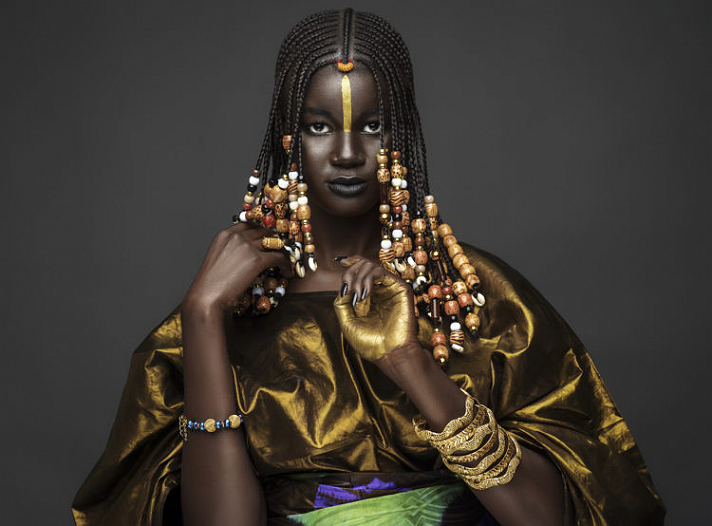 Amazing Senegalese model Khoudia Diop who dressed in traditional clothes for a photoshoot celebrating Senegals independence day.